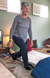 Joyce doing lunge move to get up from floor