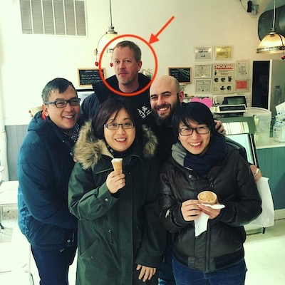 Group shot of Roy Zornow with coworkers at an ice cream store