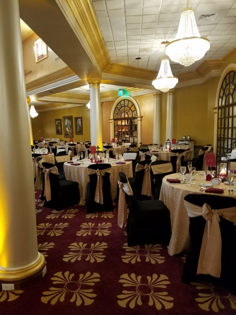 Champagne Dasmask Tablecloth and Gold Damask Sashes w/ Burgundy Napkins and Black Spandex Chair Covers