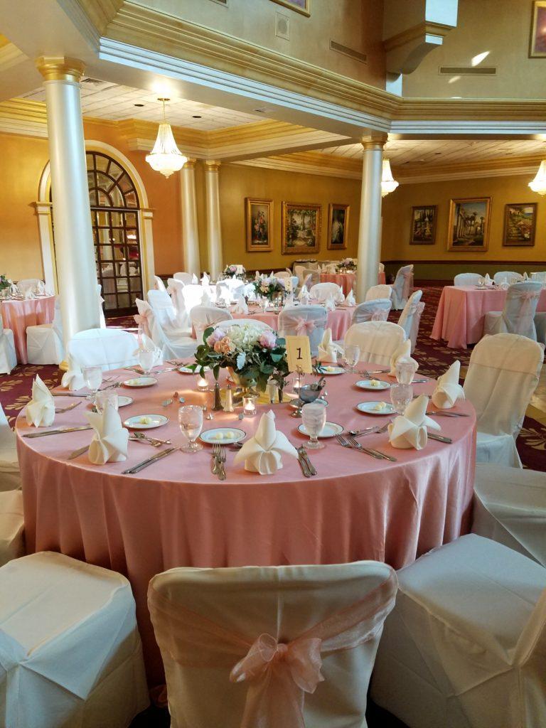 Peach Tablecloths w/ Peach Organza Sashes and Ivory Napkins