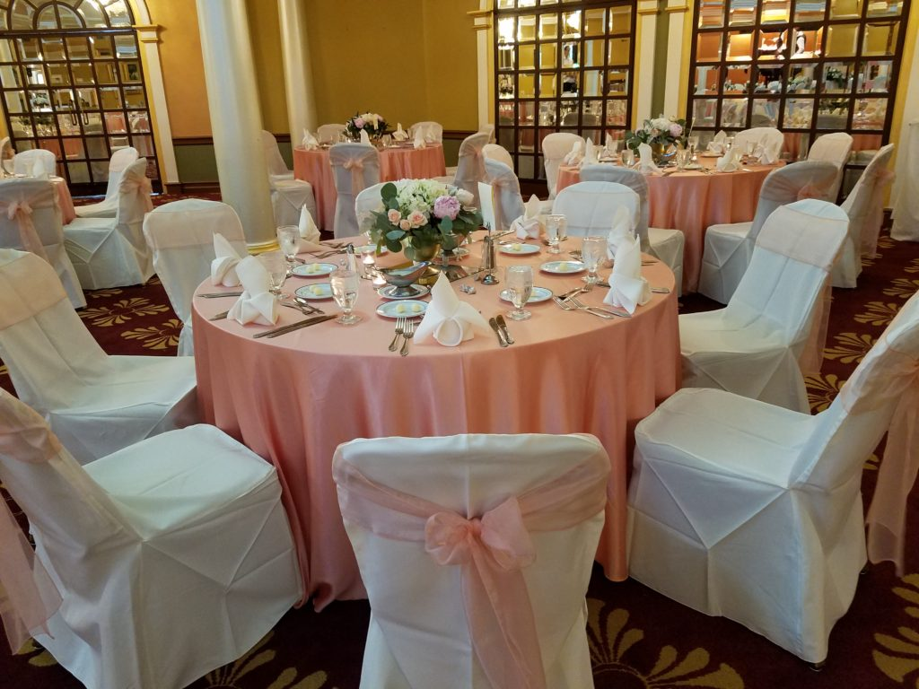 Peach Majestic Tablecloths w/ Peach Organza Sashes and Ivory Napkins