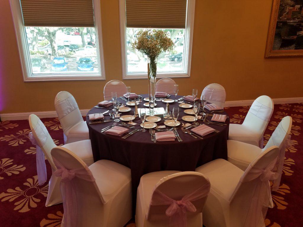 Pink Organza Sashes w/ Pink Satin Napkins and Eggplant Tablecloths