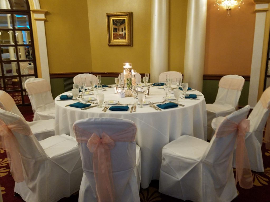 Peach Organza Sashes w/ Jade Napkins and Ivory Tablecloths