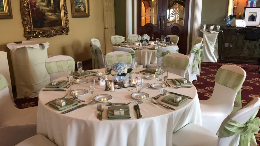 Ivory Poly Tablecloths with Celery Eternity Stripe Sashes and Light Olive Poly Napkins