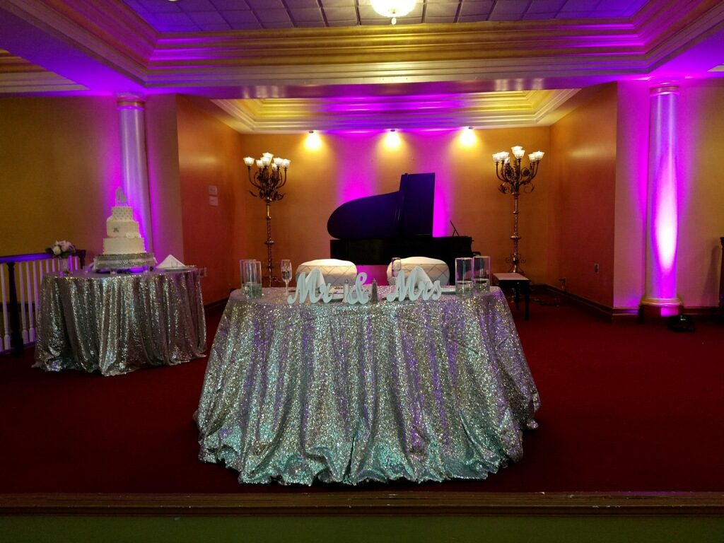 Silver Sequin Tablecloths w/ Steel Pintuck Sashes and White Spandex Chair Covers
