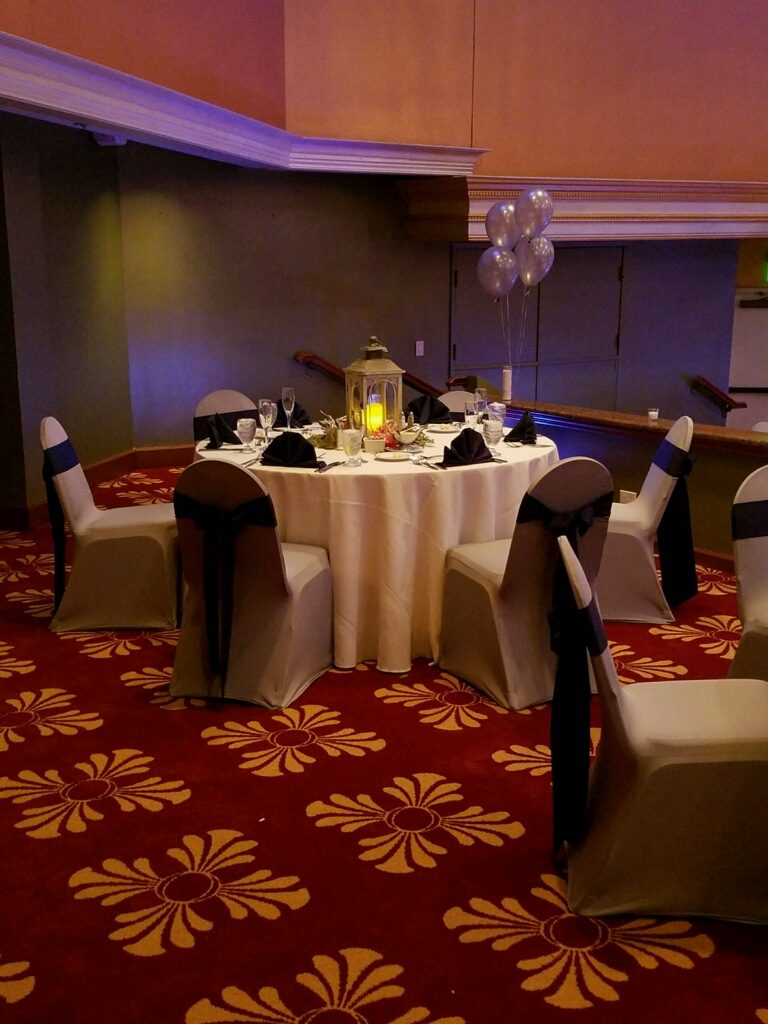 Ivory Tablecloths, Silver Spandex Chair Covers w/ Royal Blue Poly Sashes