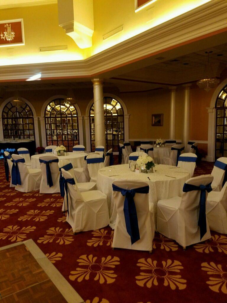 Royal Blue Sashes w/ White Damask Tablecloths