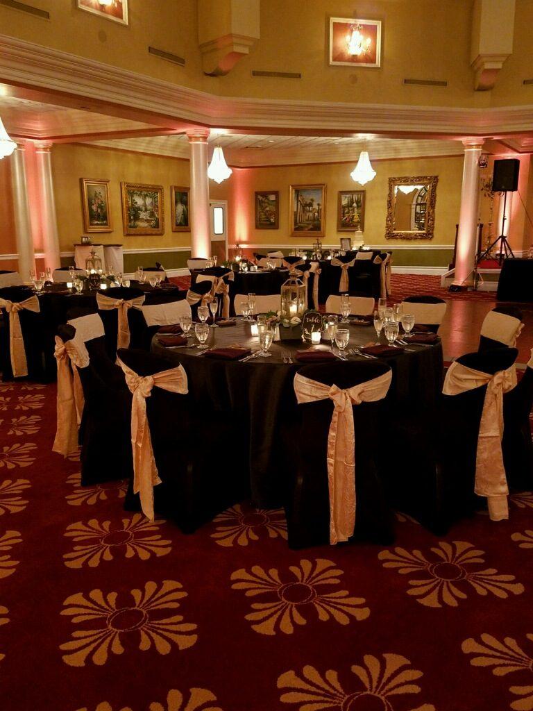 Black Tablecloths w/ Champagne Crush Sashes and Burgundy Napkins