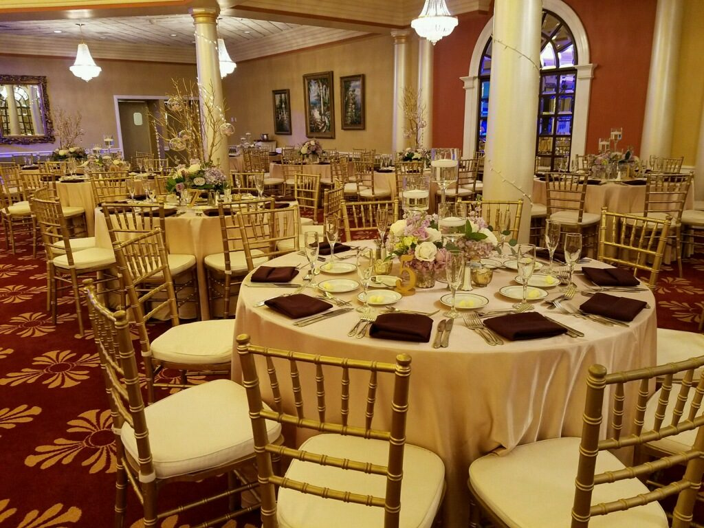 Ivory Majestic Tablecloths with Burgundy Napkins