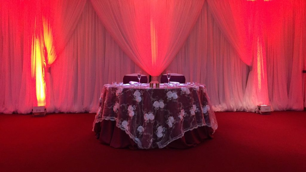 White Baby Rose Overlay w/ Red Poly Tablecloth