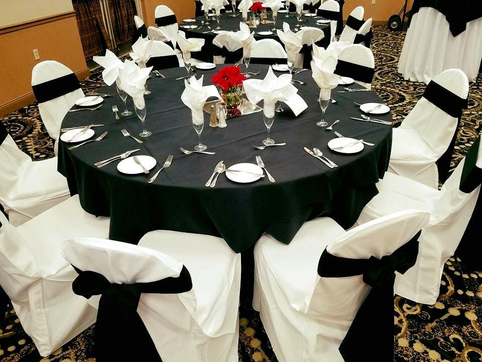 Black Sashes and Tablecloths with White Napkins