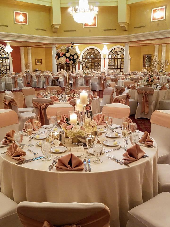 Champagne Satin Tablecloths w/ Blush Satin Sashes and Napkins w/ White Spandex Chair Covers