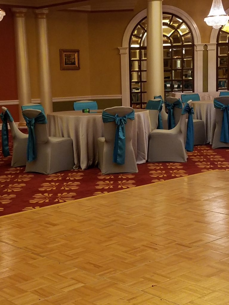 Silver Majestic Tablecloths and Turquoise Majestic Sashes