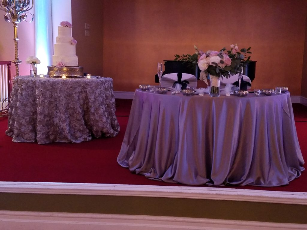 Lilac Rosette Cake Tablecloth and Lilac Majestic Sweetheart Tablecloth with Silver Crush Sashes