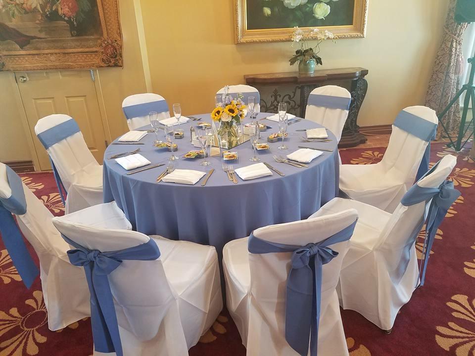 Periwinkle Sashes and Tablecloths w/ White Satin Napkins