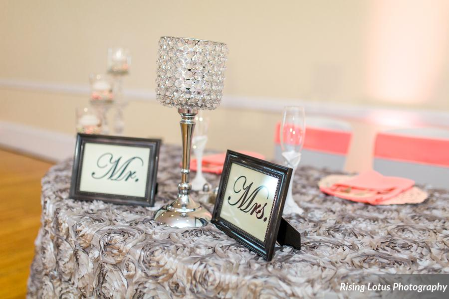Silver Rosette Tabelcoth w/ Coral Poly Sashes and White Spandex Chair Covers