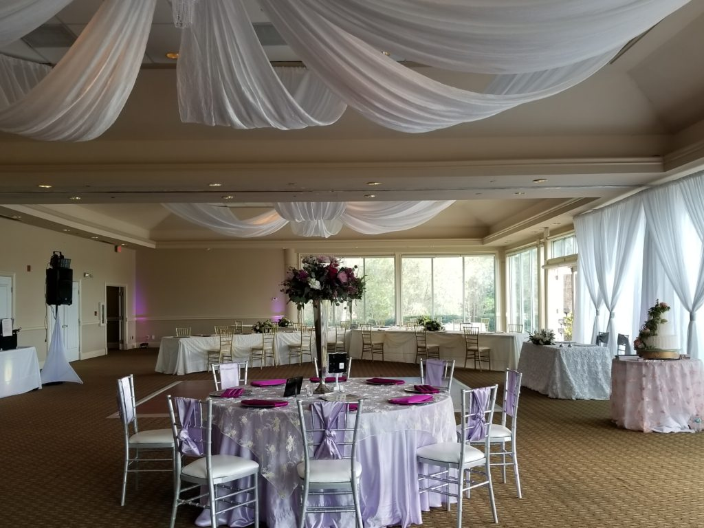 Lilac Majestic Tablecloth with Ivory Baby Rose Overlay, Lilac Majestic Sashes and Berry Majestic Napkins