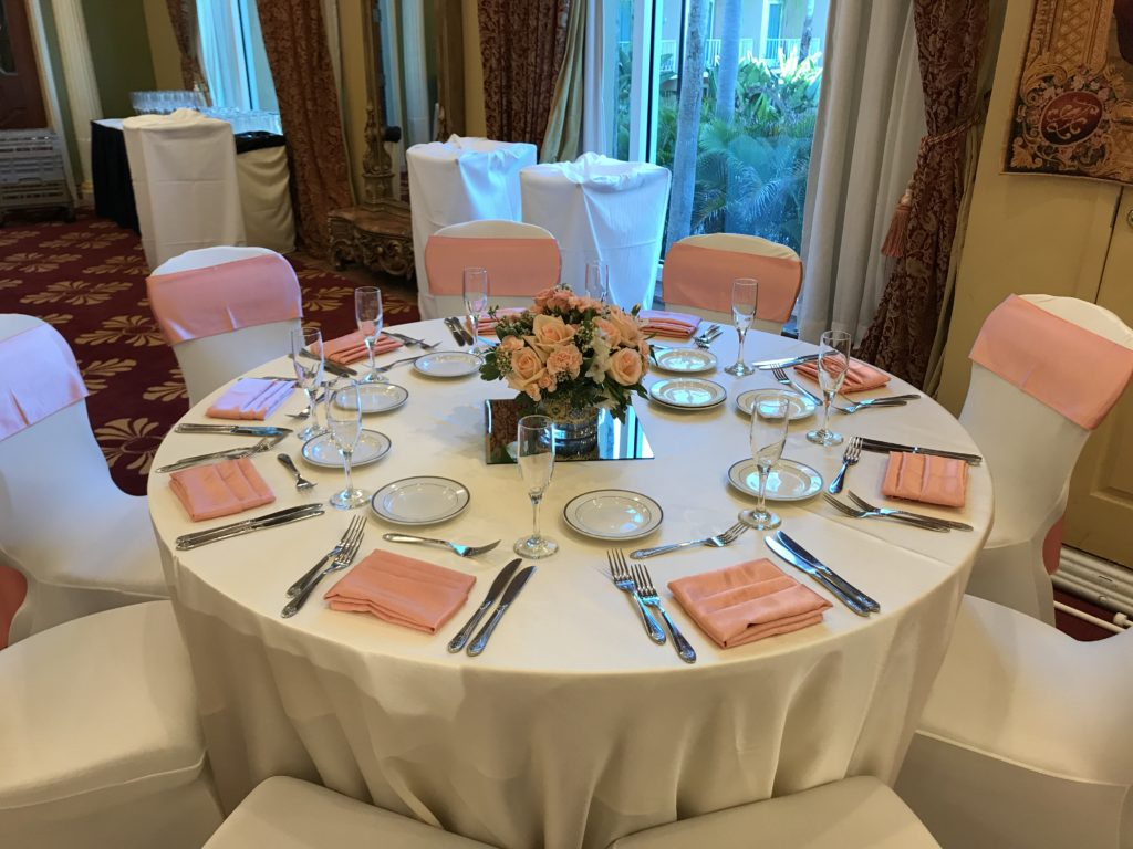 Coral Majestic Sashes and Napkins w/ White Satin Tablecloths and White Spandex Chair Covers