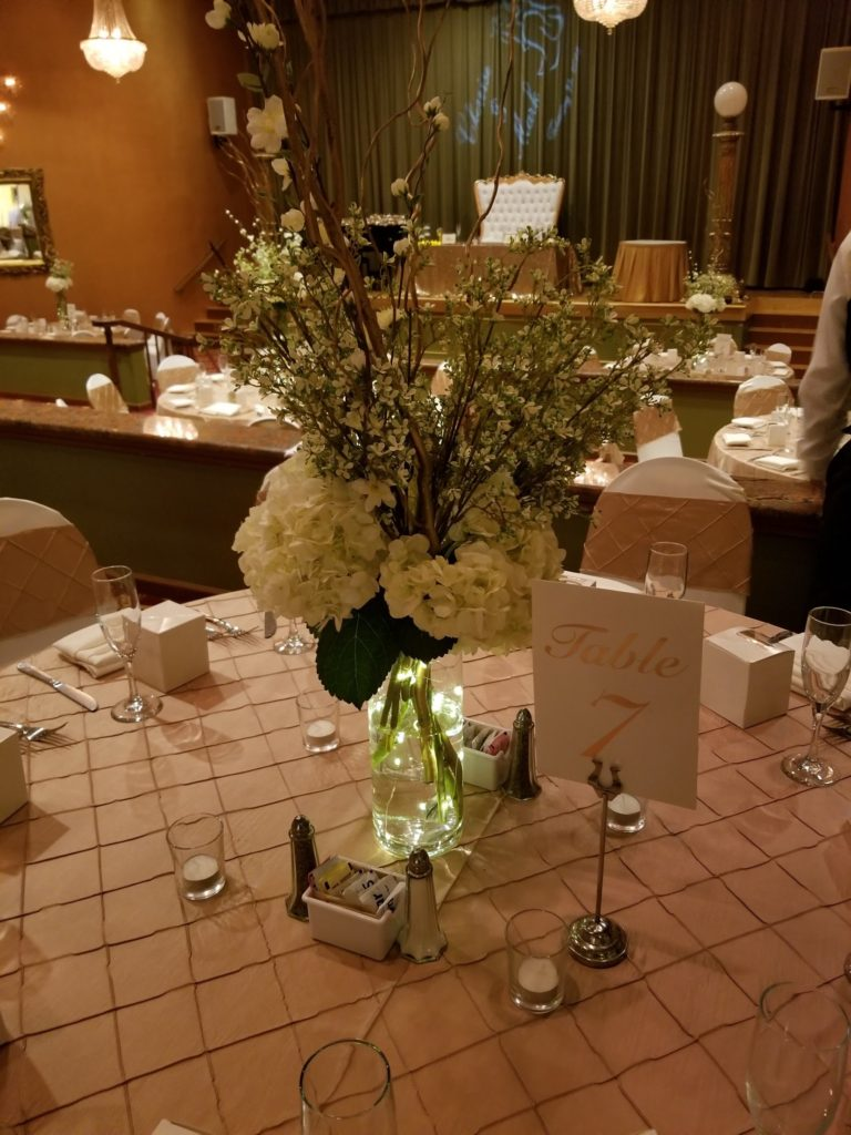 Gold Pintuck Tablecloths and Sashes w/ White Spandex Chair Covers