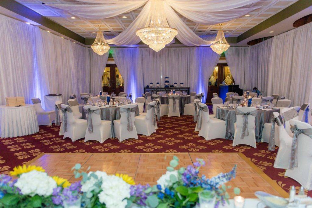 Steel Majestic Tablecloths and Silver Majestic Sashes with White Satin Napkins and White Spandex Chair Covers
