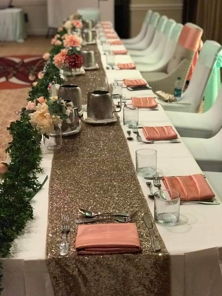 White Poly Tablecloths with Blush and Mint Satin Sashes and Blush Sequin Runner and Coral Majestic Napkins