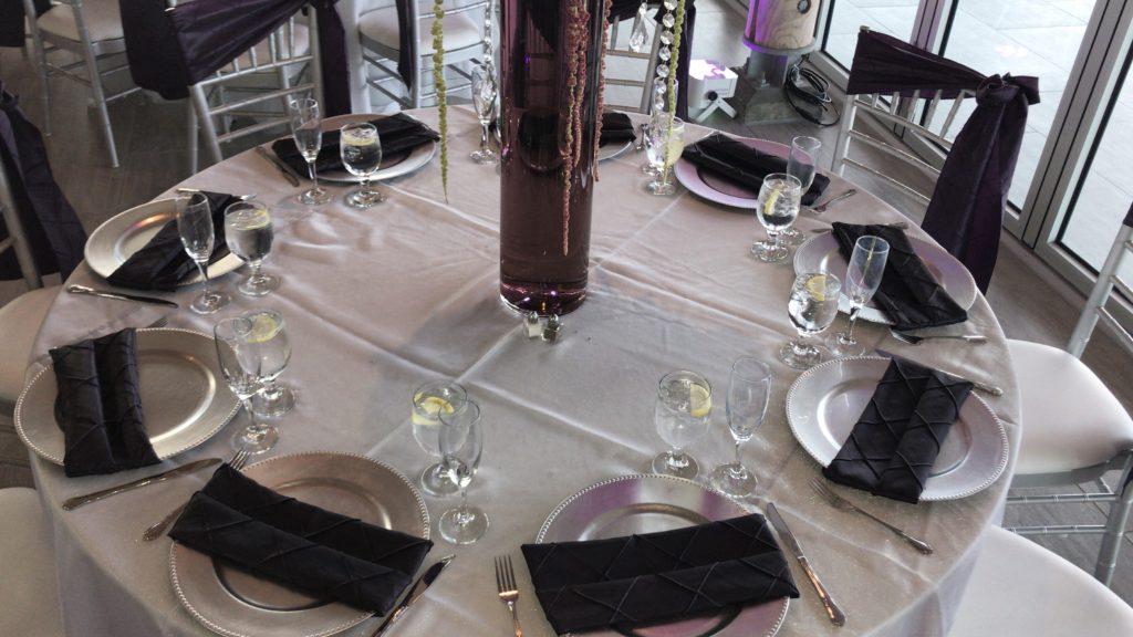 White Poly Tablecloths with Eggplant Satin Sashes and Eggplant Pintuck Napkins