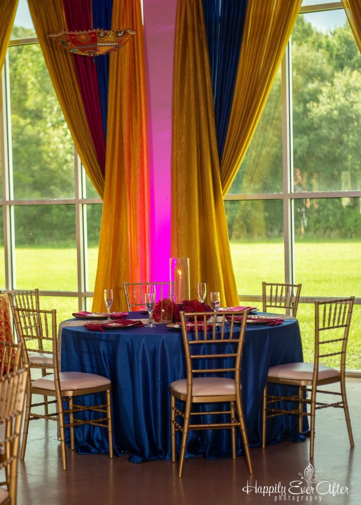 Gold Ribber Runner w/ Royal Blue Majestic Tablecloths and Fuchsia Majestic Napkins