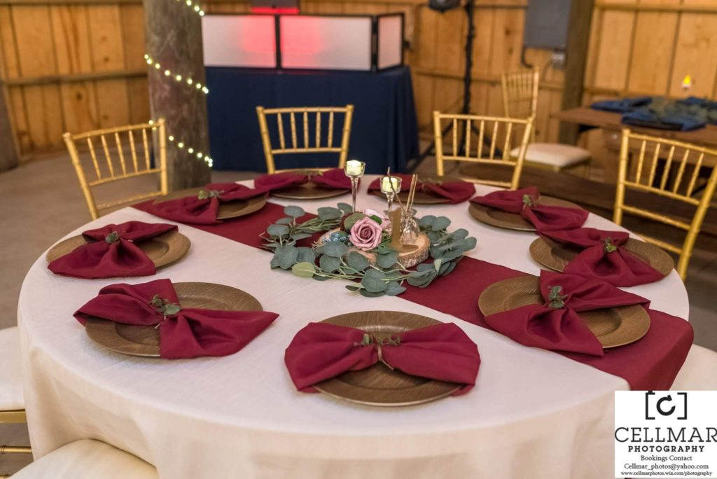 Ivory Majestic Tablecloths with Burgundy Poly Runner and Napkins