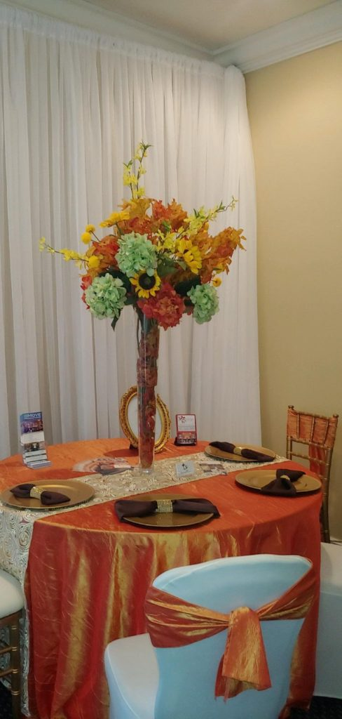 Persimmon Crush Tablecloth and Sashes w/ Gold Ribbon Overlay