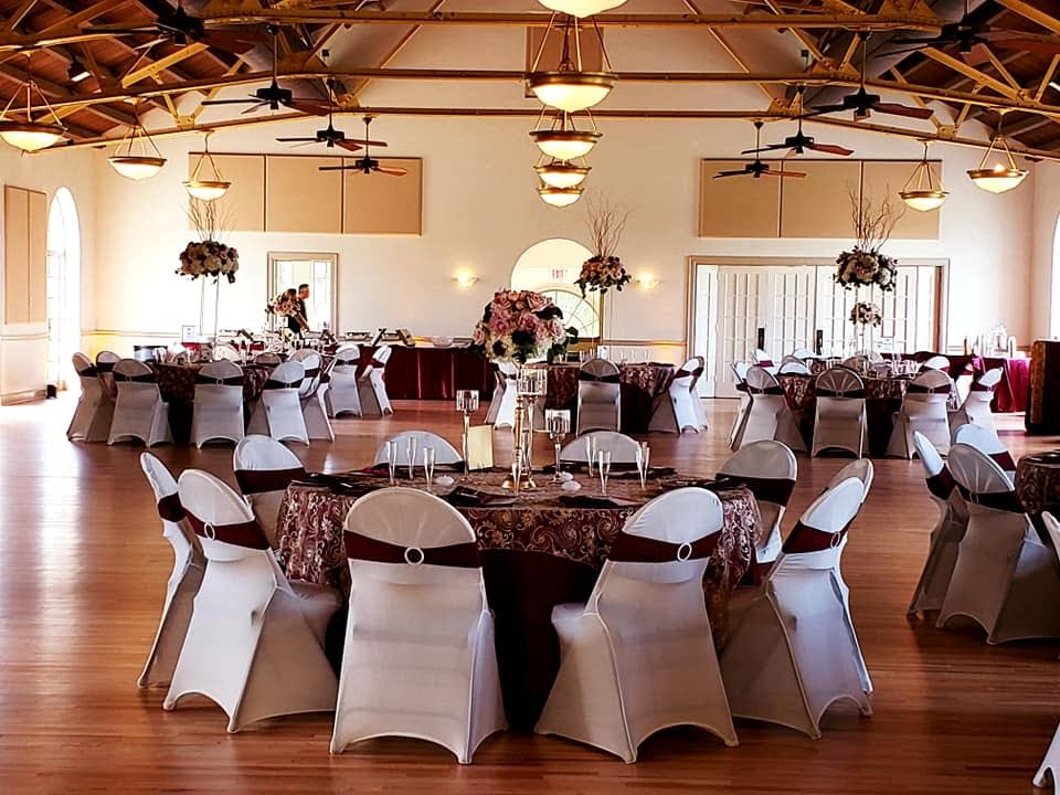 Burgundy Satin Napkins and Tablecloths w/ Gold Ribbon Tablecloth and White Spandex Chair Covers