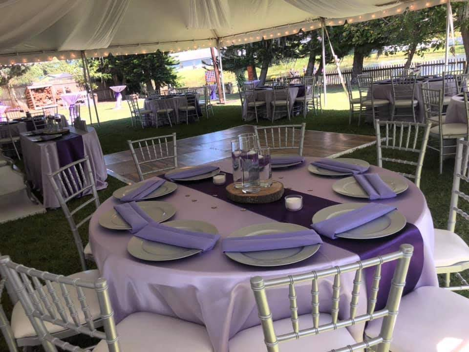 Lilac Majestic Tablecloths with Lilac Poly Napkins and Silver Chargers w/ Purple Satin Runners