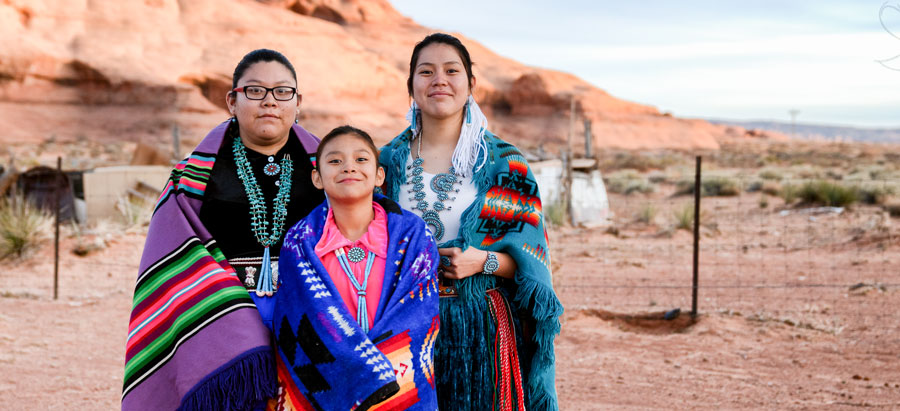 Native American Family in traditional colorful clothing