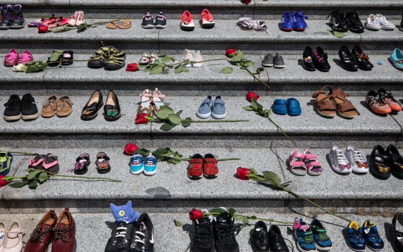 Image of children's shoes placed on the steps of the Vancouver Art Gallery as a memorial to the 215 children whose remains were found at a residential school in Kamloops.