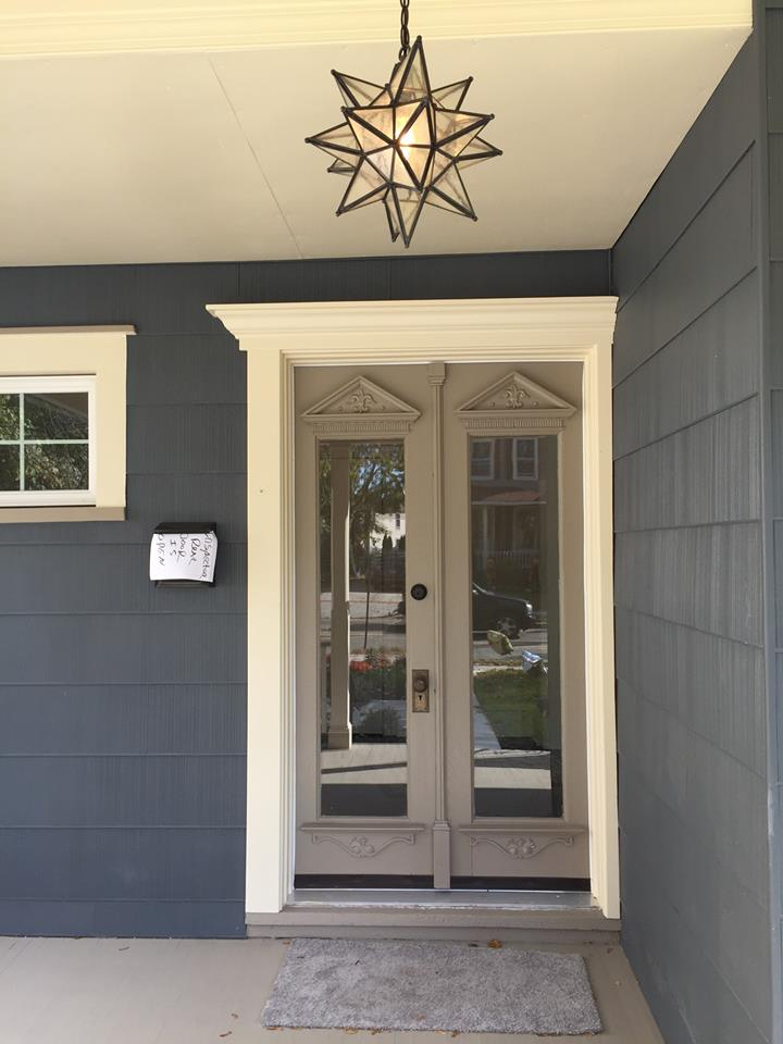 Double wooden storm doors on recently spruced up house