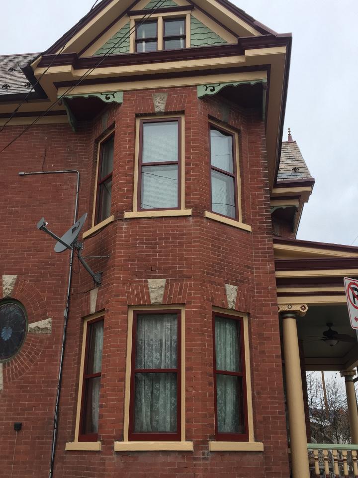 victorian home with custom storm windows