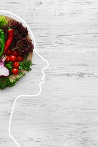 outline of a woman's profile with vegetables in the space inside her brain