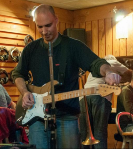 Ziv Nagari recording electric guitar in the studio