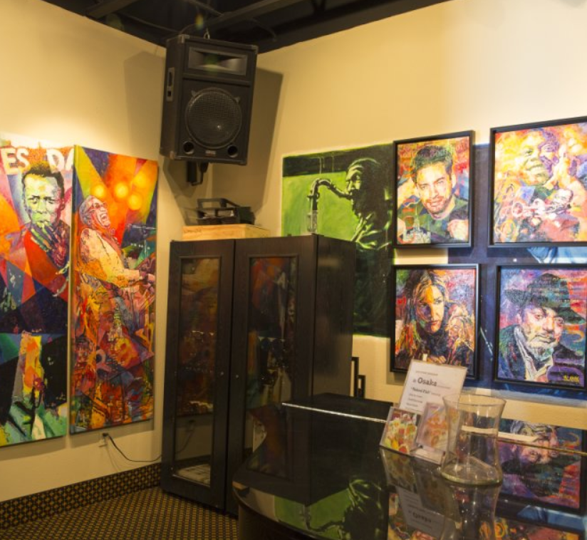 Jazz posters line the walls in Osaka Bistro Henderson's live music venue