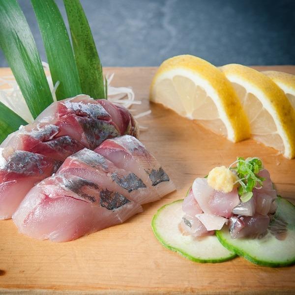 fresh cut sashimi swith lemon and cucumber at Osaka