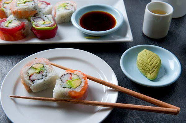 Authentic Japanese sushi meal with sushi roll, green tea, wasabi and soy sauce artistically arranged