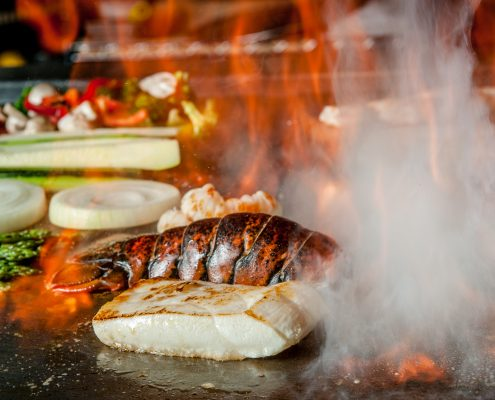 food on the teppanyaki grill at Osaka Japanese Bistro
