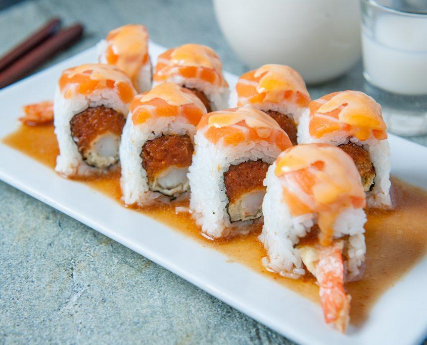 Kamisama sushi roll and a glass of sake