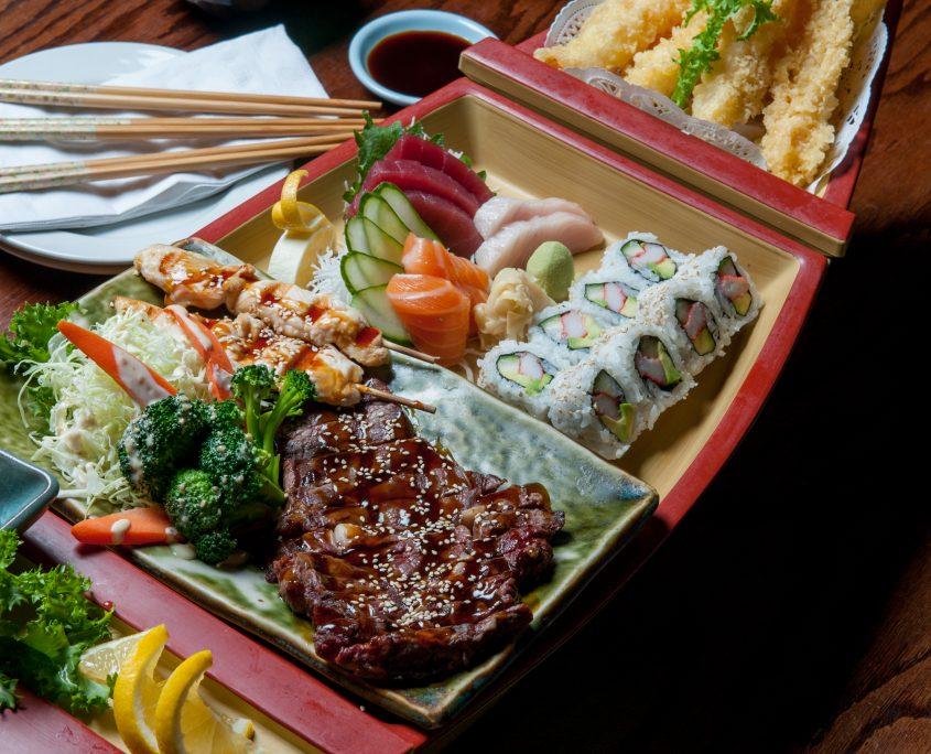 Beef Teriyaki boat with salad, sushi and tempura vegetables