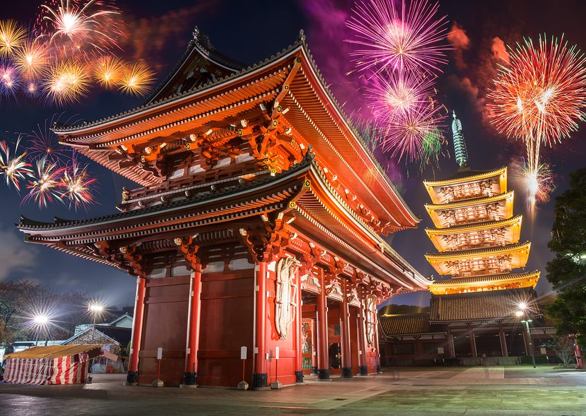 Colorful firework over abstract beautiful temple in japanese style celebrate new year at night time