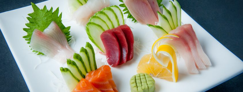 Sashimi plate fresh raw fish presented by Osaka Japanese Bistro