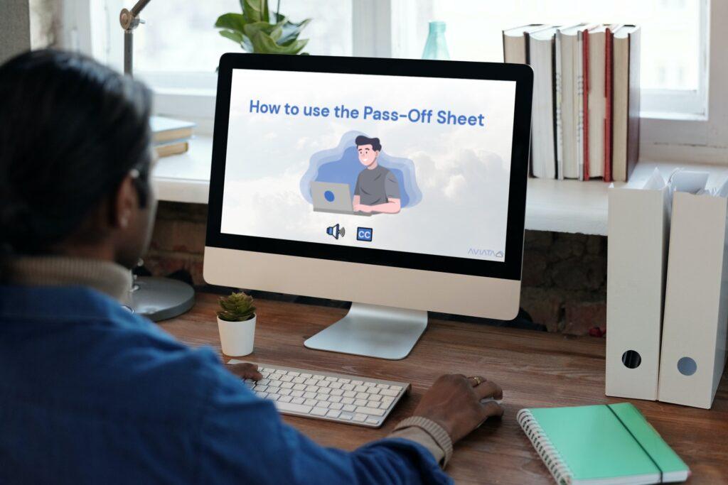 Man at computer looking at Pass-Off Sheete Training