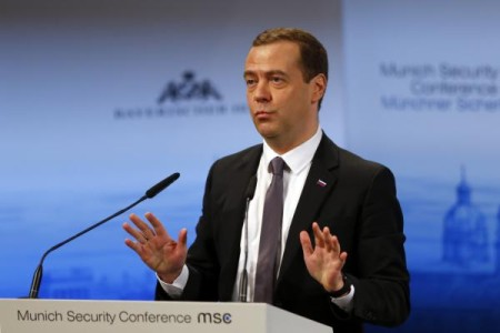 Russian Prime Minister Dmitry Medvedev gestures during his speech on the podium at the Security Conference in Munich, Germany, Saturday, Feb. 13, 2016. (AP Photo/Matthias Schrader)