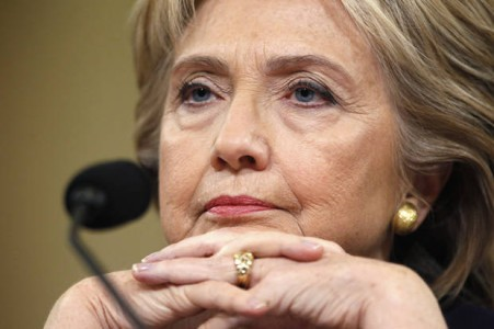 Democratic presidential candidate Hillary Clinton listens as she testifies before the House Select Committee on Benghazi, on Capitol Hill in Washington October 22, 2015. The congressional committee is investigating the deadly 2012 attack on the U.S. diplomatic mission in Benghazi, Libya, when Clinton was the secretary of state. REUTERS/Jonathan Ernst - RTS5NA6