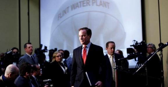Michigan Attorney General Bill Schuette enters with the Flint Water Investigative Team to announce criminal charges resulting from the Attorney General's ongoing Flint Water Investigation on April 20, 2016 at the Riverfront Banquet Center in downtown Flint, Mich. (Ryan Garza/Detroit Free Press/TNS)