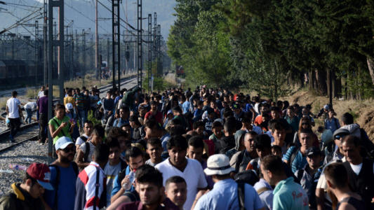 invasion9-muslims-by-train-tracks